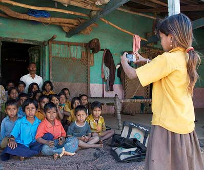 9-Child-in-Udaipur,-India-takes-photo-of-her-teacher-and-class,-Andrew-Fraker